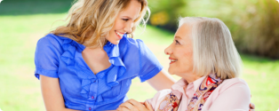 happy grandma on her wheelchair with her pretty caretaker