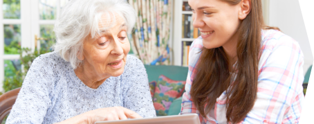 personal caretaker teaching her patient to read